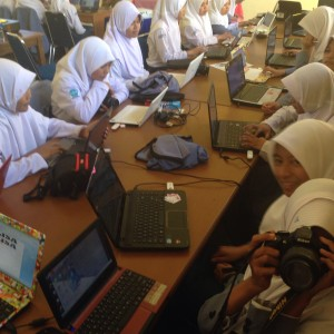 Senior High School students in South Sulawesi design zines on their laptops